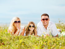 Happy family with blue sky and green grass Stock Photography