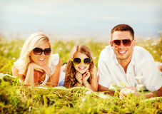 Happy family with blue sky and green grass Royalty Free Stock Photo