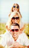 Happy family with blue sky and green grass Stock Photo
