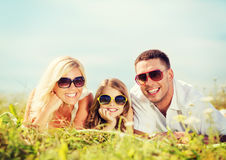 Happy family with blue sky and green grass Royalty Free Stock Image
