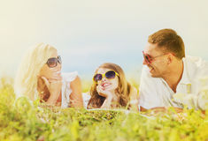 Happy family with blue sky and green grass Royalty Free Stock Photos