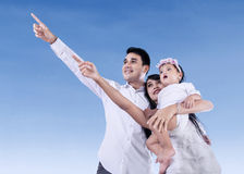 Happy family with blue sky Royalty Free Stock Image