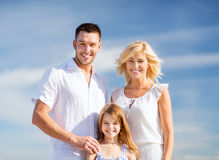 Happy family with blue sky Stock Photo