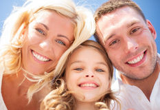 Happy family with blue sky Royalty Free Stock Photo