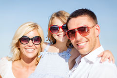 Happy family with blue sky Royalty Free Stock Images