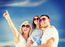 Happy family with blue sky Royalty Free Stock Photos