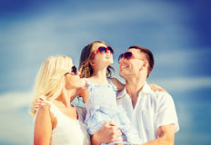 Happy family with blue sky Stock Image