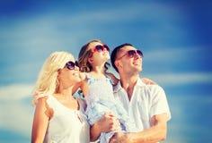 Happy family with blue sky Royalty Free Stock Photo