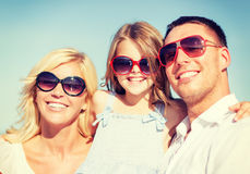 Happy family with blue sky Royalty Free Stock Photography