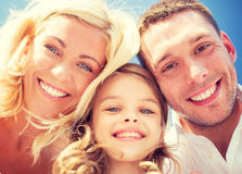 Happy family with blue sky Stock Photos