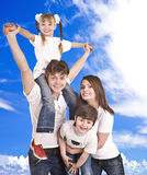 Happy family. Blue sky, white cloud. Stock Photos