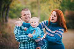 Happy family in blue stylish clothes walking in autumn forest royalty free stock image