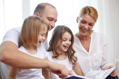 Happy family with book at home Stock Images