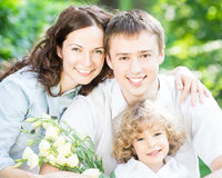 Happy family with spring flowers Stock Photo