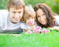 Happy family with bouquet of spring flowers Royalty Free Stock Photos