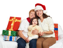 Happy family with box gift, woman with child and elderly - holiday concept Royalty Free Stock Image