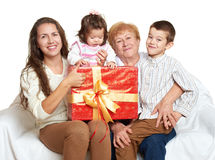 Happy family with box gift, woman with child and grandmother - holiday concept Royalty Free Stock Photos