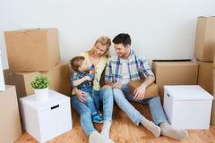 Happy family with boxes moving to new home Royalty Free Stock Photos