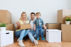 Happy family with boxes moving to new home Stock Photo