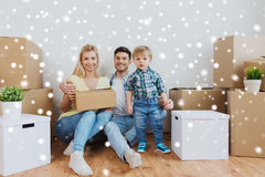 Happy family with boxes moving to new home Royalty Free Stock Image