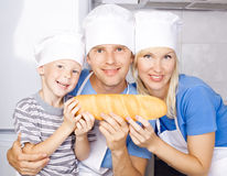 Happy family with bread Stock Images