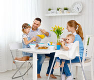 Happy family  at breakfast Royalty Free Stock Photos