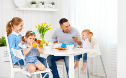 Happy family  at breakfast. Happy family mother, father and children at breakfast Stock Photos