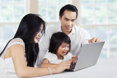 Happy family browsing internet with laptop Royalty Free Stock Images