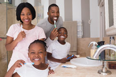 Happy family brushing teeth in bathroom at home royalty free stock photo