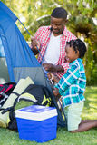 Happy family building a tent Royalty Free Stock Photo