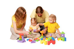 Happy family building from toy blocks Stock Images