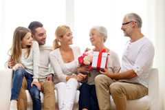 Happy family with bunch and gift box at home Royalty Free Stock Photo