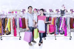 Happy family buying clothes at mall Royalty Free Stock Images