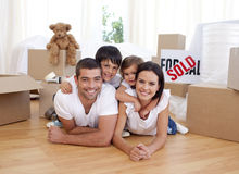Happy family after buying new house. Happy family lying on floor after buying new house Royalty Free Stock Photos