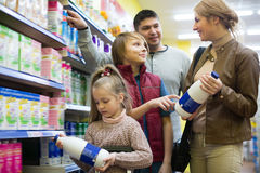 Happy family buying pasteurized milk together Stock Photography
