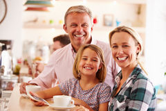 Happy family in a cafe Stock Photography