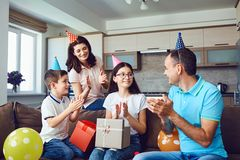 Happy family with cake on birthday party.  royalty free stock photos