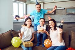 Happy family with cake on birthday party.  stock photography