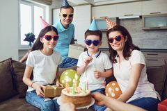 Happy family with cake on birthday party.  royalty free stock image
