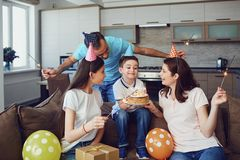Happy family with cake on birthday party.  stock photo