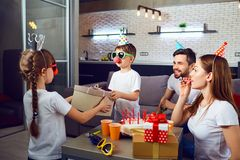 A happy family with cake celebrates a birthday party. stock photography