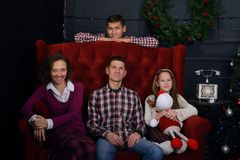 Happy family came together, in anticipation of Christmas stock photos