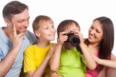 Happy family with camera Stock Images