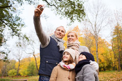 Happy family with camera in autumn  park Royalty Free Stock Images