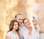 Happy family with camera at home Royalty Free Stock Image