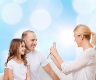 Happy family with camera at home Royalty Free Stock Photos
