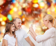 Happy family with camera at home Stock Photography
