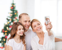 Happy family with camera at home Stock Images