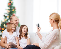 Happy family with camera at home Stock Photo