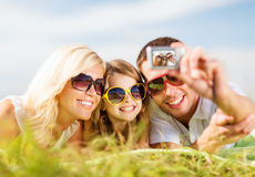 Happy family with camera taking picture Royalty Free Stock Photos